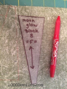 Trace the plastic template onto the back of the fabric